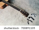 An Acoustic Guitar With New Se...