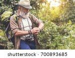cheerful senior male hiker... | Shutterstock . vector #700893685