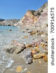 colorful mineral laced rocks on ... | Shutterstock . vector #700916575