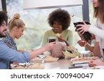 multiethnic group of happy... | Shutterstock . vector #700940047
