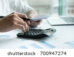 man calculate domestic bills at ... | Shutterstock . vector #700947274