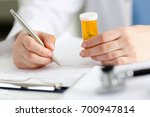 female doctor hand hold jar of... | Shutterstock . vector #700947814