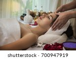 woman relaxing with hand... | Shutterstock . vector #700947919