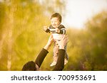 smiling mother with her son in... | Shutterstock . vector #700953691