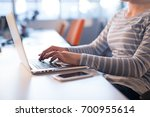 young female entrepreneur... | Shutterstock . vector #700955614