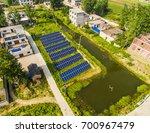solar photovoltaic in rural... | Shutterstock . vector #700967479