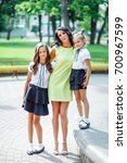 mother with two daughters is... | Shutterstock . vector #700967599