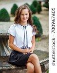 a girl in school uniform on a... | Shutterstock . vector #700967605