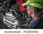 semi trucks caucasian mechanic... | Shutterstock . vector #701003401