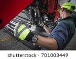 truck service oil level check... | Shutterstock . vector #701003449