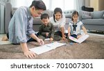 father and mother teaching... | Shutterstock . vector #701007301