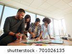 group of young people working... | Shutterstock . vector #701026135