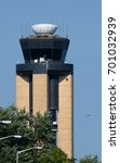Small photo of Air Traffic Control Tower with Plane