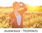 female farmer standing in a... | Shutterstock . vector #701043631