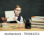 student child holding book... | Shutterstock . vector #701061211