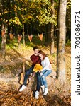 autumn picnic. happy couple... | Shutterstock . vector #701086771