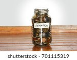 a glass jar full of coins to... | Shutterstock . vector #701115319