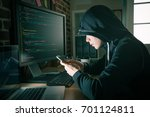 Small photo of pretty beauty girl hacker using mobile cell phone searching online information and preparing to blackmail money when she working at night.
