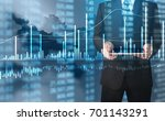 investment concept hand with... | Shutterstock . vector #701143291