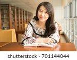 asian girl in library | Shutterstock . vector #701144044