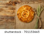 naan bread on a wooden table....   Shutterstock . vector #701153665