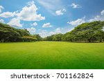 Small photo of Green grass green trees in beautiful park white Clouds and blue sky in noon. Beautiful park scene in public park with green grass field, green tree plant and a party cloudy blue sky.