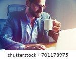 handsome businessman drinking... | Shutterstock . vector #701173975