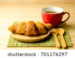 croissant and red cup of coffee ... | Shutterstock . vector #701176297