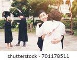 young female graduate hugging... | Shutterstock . vector #701178511