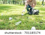 young man crouching to waste... | Shutterstock . vector #701185174