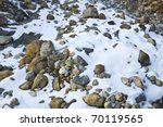 Snow and rock - stock photo