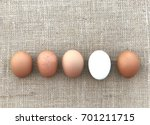 closeup a white egg among beige ... | Shutterstock . vector #701211715