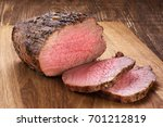 baked meat on a wooden...