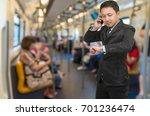 asian businessman calling... | Shutterstock . vector #701236474