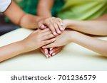 hands of three people.... | Shutterstock . vector #701236579