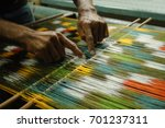 weaving and manufacturing of handmade carpets closeup. man