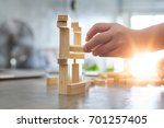 hand of kid playing a blocks... | Shutterstock . vector #701257405
