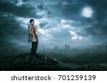 spooky asian zombie man with...   Shutterstock . vector #701259139