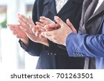 Small photo of Business people clapping hands in the meeting