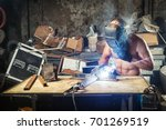 a young male welder in a... | Shutterstock . vector #701269519