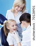 The dentist makes examination of the child - stock photo
