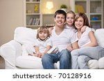 smiling family home evening   Shutterstock . vector #70128916
