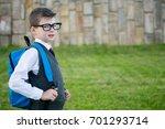 pupil of the school  walks with ... | Shutterstock . vector #701293714