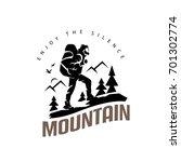 tourist climbs the mountain... | Shutterstock .eps vector #701302774