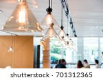 hanging ceiling lights in a... | Shutterstock . vector #701312365