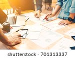 brainstorming team of asian...   Shutterstock . vector #701313337