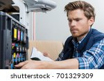young male technician is... | Shutterstock . vector #701329309