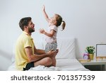 father and his daughter are... | Shutterstock . vector #701357539