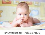 the baby is lying on a yellow... | Shutterstock . vector #701367877