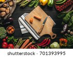 top view of cutting board with... | Shutterstock . vector #701393995